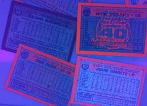 Reverse Glow of 1991 Topps Desert Shield Cards under UV Light